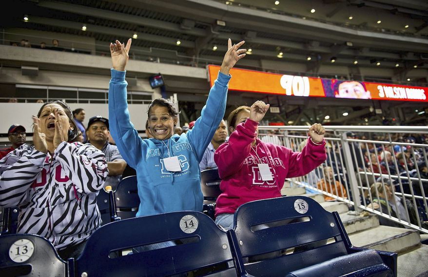 Maria Campos (left), Wilson Ramos' mother, is joined by her daughter Milanyela Ramos (center) and family friend Marfa Mata as they cheer on her son as he comes to the plate,Tuesday. They are visiting from Valenzuela. (Rod Lamkey Jr./The Washington Times)