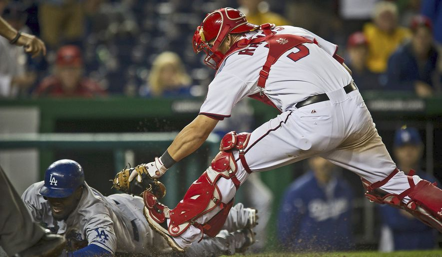 Nationals catcher Wilson Ramos, tagging out the Los Angeles' Dodgers' Tony Gwynn, Jr., on Tuesday, is hitting .294 since Aug. 1. The rookie is batting .261 with 12 home runs and 43 RBI. (Rod Lamkey Jr./The Washington Times)