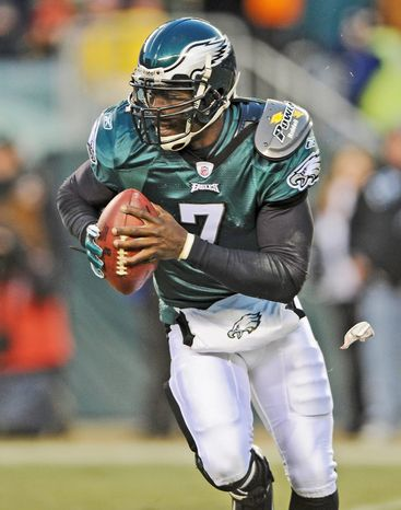 In this Jan. 9, 2011, photo, Philadelphia Eagles quarterback Michael Vick (7) runs from a tackler during the first half of an NFL wild card playoff football game against the Green Bay Packers in Philadelphia. Vick and the Eagles have agreed on a six-year deal. The Eagles made the announcement Monday night, Aug 29, 2011. A source familiar with the negotiations told The Associated Press the deal is worth $100 million, including about $40 million guaranteed. The person spoke to the AP on condition of anonymity because terms weren't released. (AP Photo/Michael Perez)