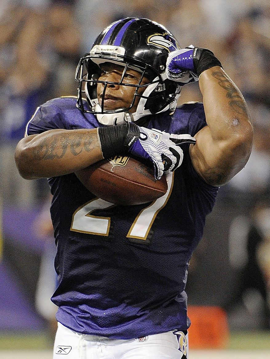 Ravens RB Ray Rice (above) figures to be a workhorse around the goal line with Willis McGahee now in Denver. The Eagles' Michael Vick (inset) is still a thrill-a-minute QB, but can his offensive line keep him upright? For yardage and TDs, you could do worse than hitching your wagon to Redskins RB Tim Hightower (below). (Associated Press photographs)