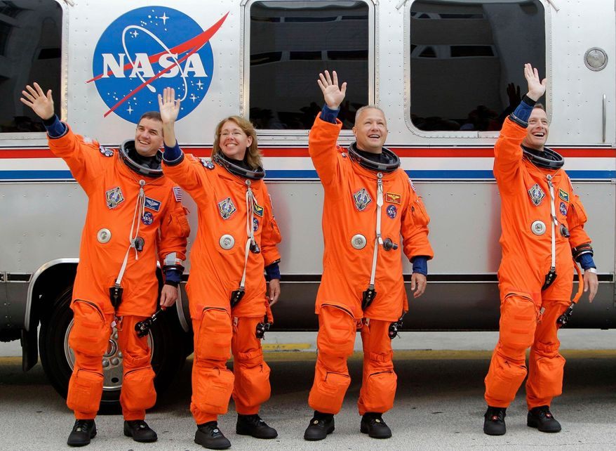 ASSOCIATED PRESS The space shuttle Atlantis astronauts [from left] mission specialists Rex Walheim and Sandy Magnus, pilot Doug Hurley and commander Chris Ferguson acknowledge well-wishers after leaving the operations and checkout building en route to the launching pad at the Kennedy Space Center on July 8 at Cape Canaveral, Fla. Atlantis was the 135th and final space shuttle launch for NASA.