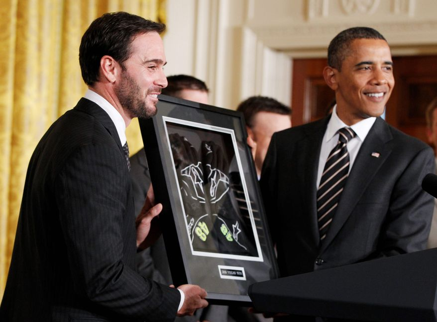ASSOCIATED PRESS Five-time defending NASCAR champion Jimmie Johnson presents driving gloves to President Obama at the White House on Wednesday. Mr. Obama honored Johnson and seven other drivers from last year's Chase for the Sprint Cup series.