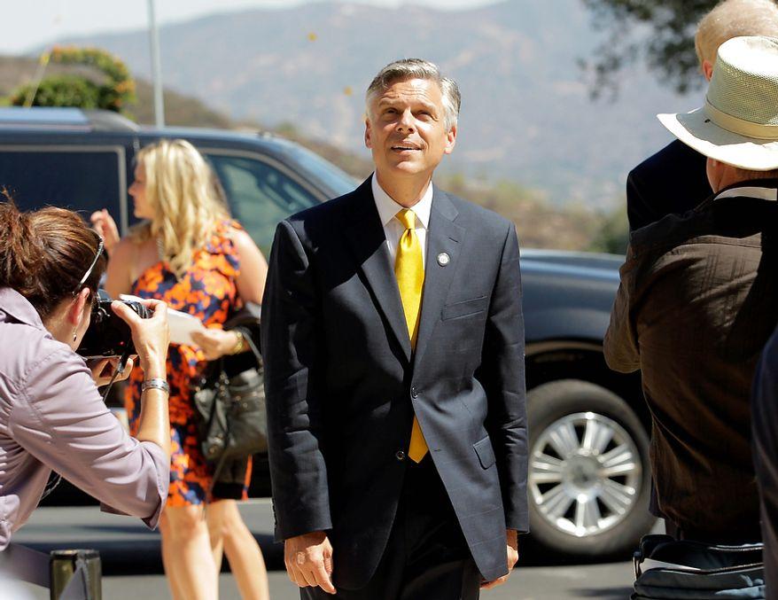Republican presidential candidate former Utah Gov. Jon Huntsman arrives at the Reagan Library for a Republican presidential candidate debate Wednesday, Sept. 7, 2011, in Simi Valley, Calif.  (AP Photo/Jae C. Hong)