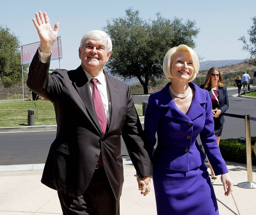 Former House Speaker and Republican presidential candidate Newt Gingrich and his wife, Callista, arrive at the Reagan Library for a Republican presidential candidate debate Wednesday, Sept. 7, 2011, in Simi Valley, Calif.  (AP Photo/Jae C. Hong)