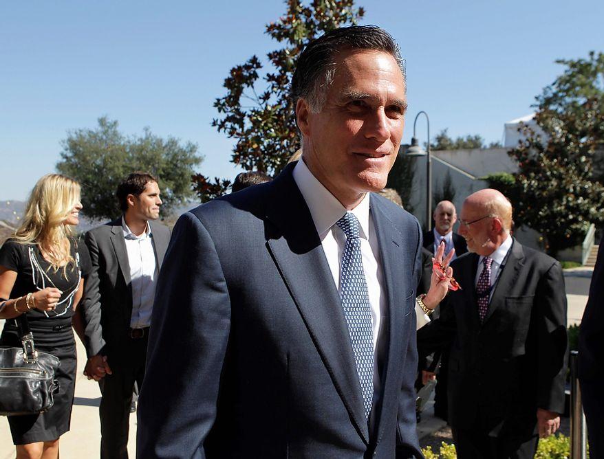 Republican presidential candidate former Massachusetts Gov. Mitt Romney arrives for a Republican presidential candidate debate at the Reagan Library Wednesday, Sept. 7, 2011, in Simi Valley, Calif.  (AP Photo/Jae C. Hong)