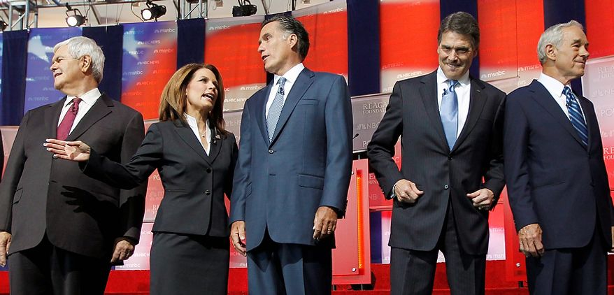 Republican presidential candidates, from left, former House Speaker Newt Gingrich, Rep. Michele Bachmann, R-Minn., former Massachusetts Gov. Mitt Romney, Texas Gov. Rick Perry, and Rep. Ron Paul, R-Texas., stand together before a Republican presidential candidate debate at the Reagan Library Wednesday, Sept. 7, 2011, in Simi Valley, Calif.  (AP Photo/Chris Carlson)
