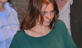 American student Amanda Knox arrives at court in Perugia, Italy, on Wednesday, Sept. 7, 2011, for a hearing of her appeals case in the death of her British roommate. (AP Photo/Stefano Medici)