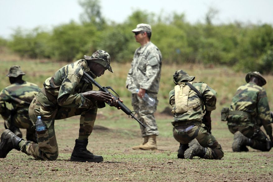 ** FILE ** A U.S. Special Forces soldier trains troops from Senegal in combat techniques in Kati, Mali, during a joint training exercise with units from several African armies in the Sahara Desert in June 2010. Al Qaeda in the Islamic Maghreb wants to put its footprint on the Arab Spring now that violence is fueling the uprisings. (AP Photo/Alfred de Montesquiou, File)