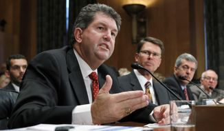 Postmaster General Patrick Donahoe (left) appears Sept. 6, 2011, on Capitol Hill before the Senate Homeland Security and Governmental Affairs Committee as the panel examines the economic troubles of the Postal Service, a self-funded federal agency in decline because of the Internet and advertising losses. (Associated Press)