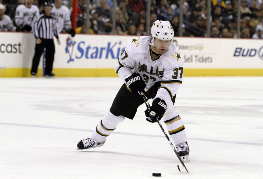 ** FILE ** Karlis Skrastins of Latvia, then with the Dallas Stars, controls the puck during an the NHL hockey game against the Pittsburgh Penguins in Pittsburgh in March 2010. A Russian jet carrying a top ice hockey team crashed just after takeoff on Wednesday, Sept. 7, 2011, killing at least 43 people, including Skrastins. (AP Photo/Keith Srakocic, File)