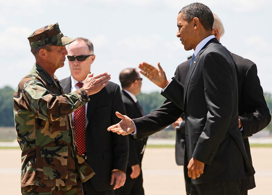 DON'T USE THIS CAPTION XXXXX DON'T USE THIS CAPTION President Barack Obama returns a salute to Navy Adm. Eric T. Olson, commander of U.S. Special Operations Command, as he steps off Air Force One at Campbell Army Airfield in Fort Campbell, Ky., Friday, May 6, 2011. (AP Photo/Charles Dharapak)