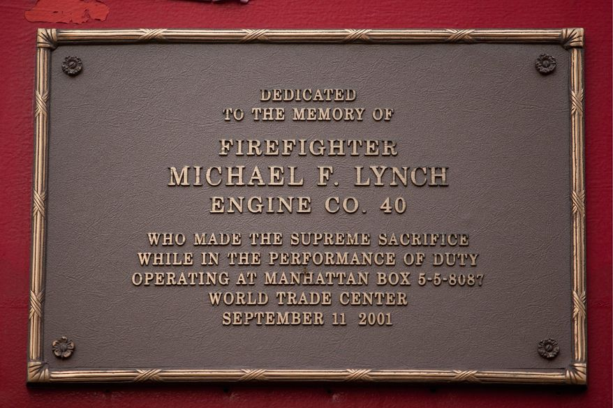 The firehouse at 66th and Amsterdam has a small garden honoring the firefighters who gave their lives in the 9/11 terrorist attacks in New York, NY, on Thursday September 1, 2011. (Andrew Harnik / The Washington Times)