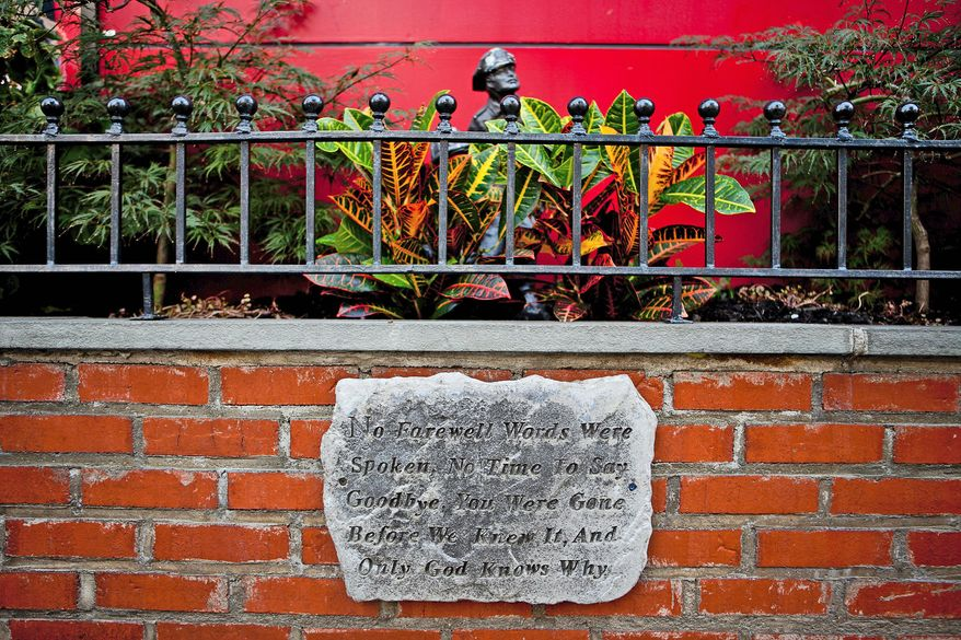 A plaque is displayed at the firehouse at 66th and Amsterdam at a garden honoring the firefighters who gave their lives in the 9/11 terrorist attacks in New York, NY, on Thursday September 1, 2011. (Andrew Harnik / The Washington Times)