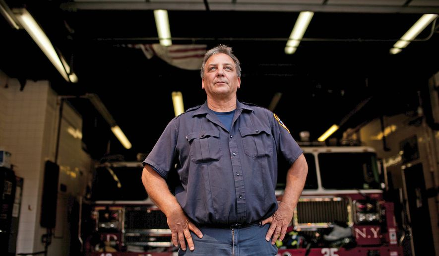 PHOTOGRAPHS BY ANDREW HARNIK/THE WASHINGTON TIMES Firefighter Mike Kotula lost 12 friends and firefighters in his station and says he could count 100 of the firefighters killed in the Sept. 11 terrorist attacks with whom he has had some contact with over the years.