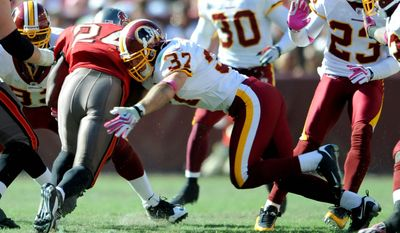 Reed Doughty (37) of the Washington Redskins tackles Carnell Williams (24) of the Tampa Bay Buccaneers in the fourth quarter at FedEx Field in Landover, Md., Sunday, October 4, 2009. (Peter Lockley / The Washington Times)