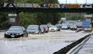 Cars drive through high water on Route 50 in Cheverly, Md., Wednesday, Sept. 7, 2011. As the leftovers from Tropical Storm Lee brought welcome wet weather to farmers in the Southeast, many areas of the East Coast were getting soaked, bringing new concerns about flooding. (AP Photo/Susan Walsh)