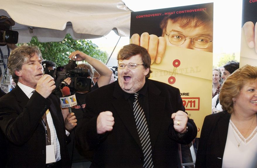 """**FILE** Film director Michael Moore (center) chanted for Harvey Weinstein (not shown), head of Miramax films, to join him for a photo at the D.C. premiere of """"Fahrenheit 9/11"""" on June 23, 2004. Celebrity superagent Ken Sunshine (left) joined in. (The Washington Times)"""