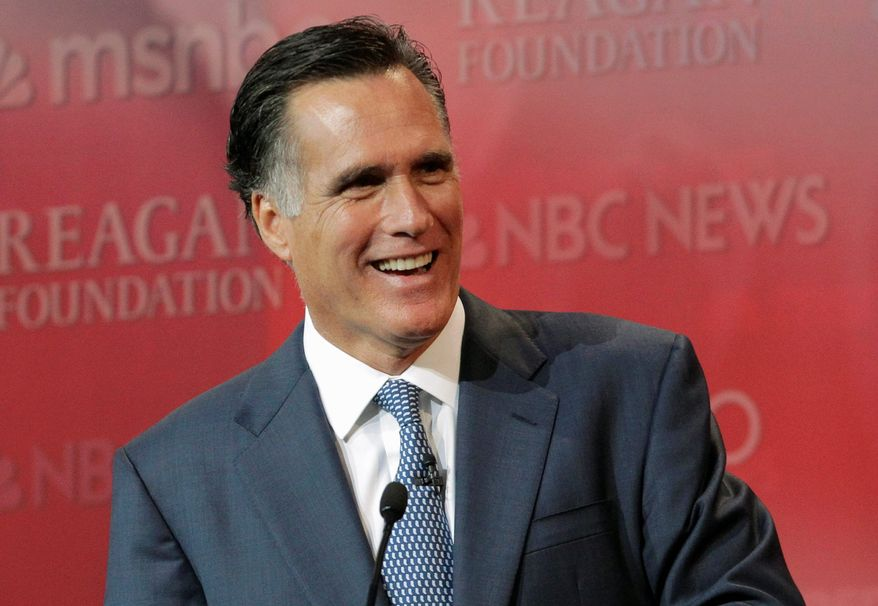 Republican presidential candidate Mitt Romney shares a light moment Wednesday during the Republican presidential candidate debate at the Reagan Library in Simi Valley, Calif. For now, he has relinquished his front-runner status to main rival Texas Gov. Rick Perry. (Associated Press)