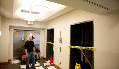 Don Simpson, owner of Simpson Development, looks at the lobby of one of his properties, Alexandria Tech Center II, along Eisenhower Avenue in Alexandria, Va., on Sept. 9, 2011. The property, which had flood waters in its elevators, lobby and parking lot, was built with a first-floor parking lot so that office spaces wouldn't be damaged by flooding, Mr. Simpson said. (Andrew Harnik/The Washington Times)