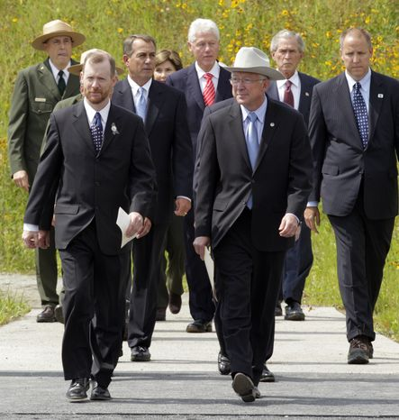 Gordon Felt front left, President of Families of Flight 93 whose brother Edward was a passenger on Flight 93, walks alongside Secretary of the Interior Ken Salazar as Speaker of the House John Boehner, former President Bill Clinton and former President George W. Bush walk behind as they walk to the stage at the dedication of phase 1 of the permanent Flight 93 National Memorial near the crash site of Flight 93 in Shanksville, Pa., Saturday Sept. 10, 2011. (AP Photo/Gene J. Puskar)