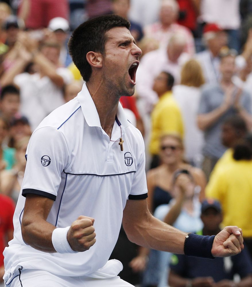 Novak Djokovic reacts after winning a semifinal match against Roger Federer at the U.S. Open tennis tournament in New York on Saturday, Sept. 10, 2011. (AP Photo/Charles Krupa)