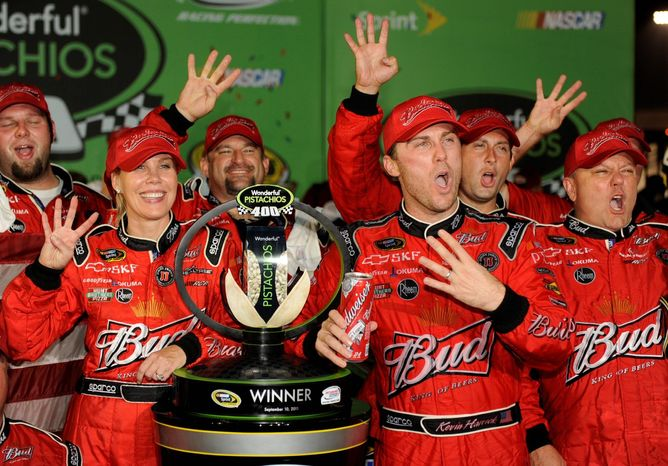 Kevin Harvick and his wife, DeLana, celebrate his Sprint Cup victory Saturday night at Richmond International Raceway. (Associated Press)