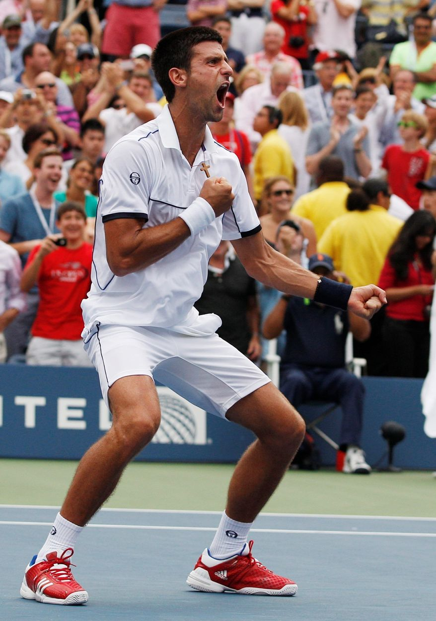 Novak Djokovic reacts after ousting Roger Federer in the U.S. Open semifinals Saturday and improving to 63-2 in 2011. (Associated Press)