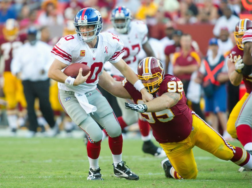 Redskins nose tackle Chris Neild, pressuring Eli Manning in the third quarter, had two sacks of the Giants' quarterback. The Redskins opened the season with a 28-14 win over their NFC East rival. (Rod Lamkey Jr./The Washington Times)