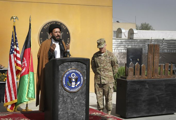 Mohammad Mubarez, an Afghan cleric, prays during an event to mark the 10th anniversary of the Sept. 11 attack on the United States, at the U.S. embassy in Kabul, Afghanistan, Sunday, Sept. 11, 2011. (AP Photo/Musadeq Sadeq)