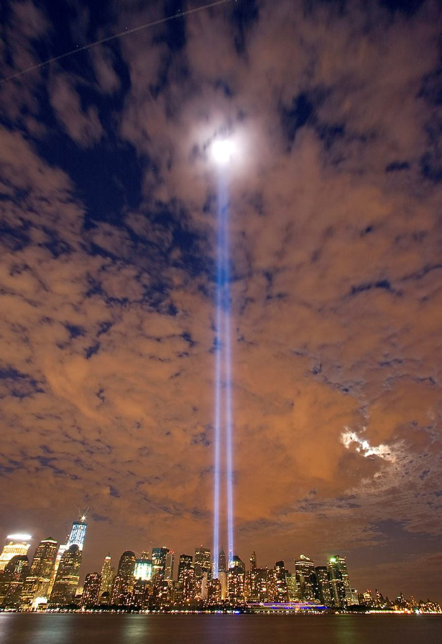 The Tribute in Light shines over lower Manhattan seen from Liberty State Park in Jersey City, N.J. shortly after sunset Saturday, Sept. 10, 2011. Sunday will mark the 10th anniversary of the September 11 attacks on the United States. (AP Photo/Jim Gerberich)
