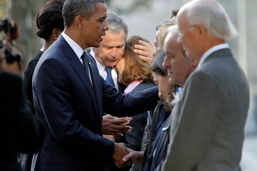 President Barack Obama and former President George W. Bush greet family members of those who died during the attacks on the World Trade Center at the National September 11 Memorial during a ceremony marking the 10th anniversary of the attacks at World Trade Center, Sunday, Sept. 11, 2011 in New York.  (AP Photo/Mary Altaffer)