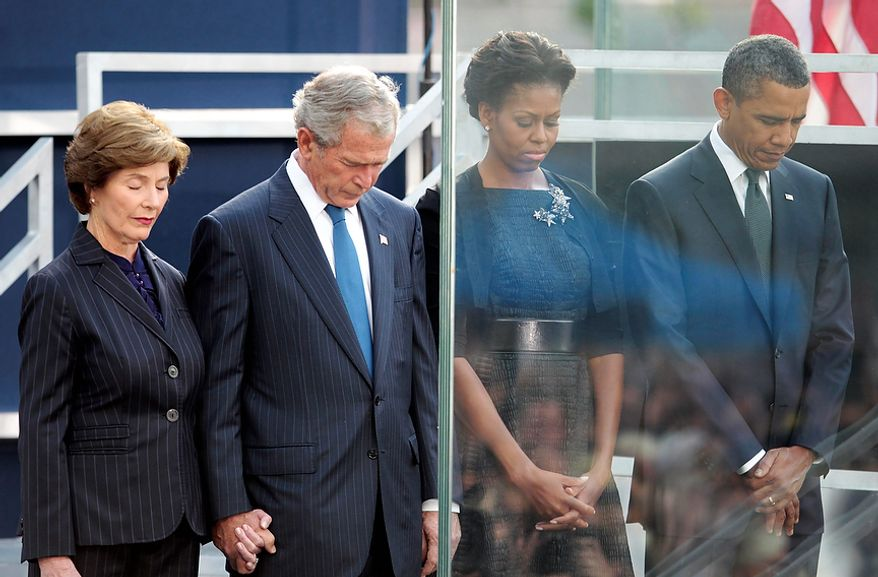 President Barack Obama and first lady Michelle Obama, former President George W. Bush and former first lady Laura Bush bow their heads during a moment of silence at the Sept. 11 10th Anniversary Commemoration Ceremony at Ground Zero in New York, Sunday, Sept., 11, 2011 in New York. (AP Photo/Pablo Martinez Monsivais)