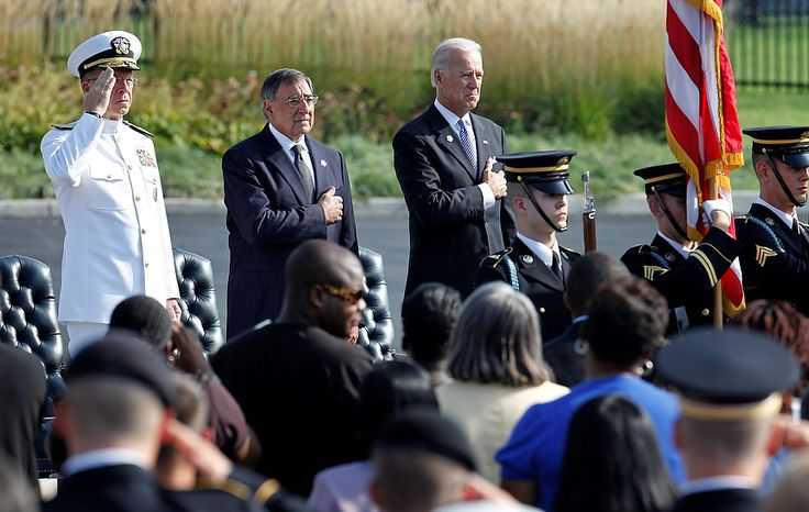 Adm. Mike Mullen (left), chairman of the Joint Chiefs of Staff; Defense Secretary Leon E. Panetta; and Vice President Joseph R. Biden Jr. stand during the national anthem at the 10th anniversary ceremony of the Sept. 11 attacks at the Pentagon outside Washington on Sunday, Sept. 11, 2011. (AP Photo/Charles Dharapak)