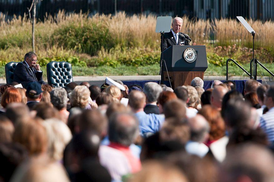 Vice President Joseph R. Biden Jr. speaks during the commemoration of the Sept. 11, 2001, attack on the Pentagon as Defense Secretary Leon E. Panetta (left) listens at the Pentagon Memorial in Arlington on Sunday, Sept. 11, 2011. (T.J. Kirkpatrick/The Washington Times)