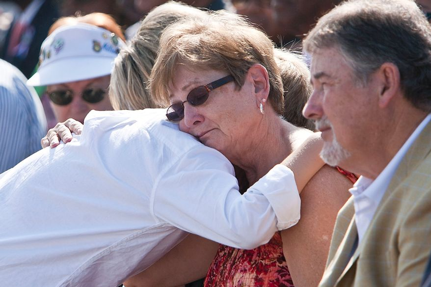 Patricia Fallon (center) of Woodbridge, Va., receives a hug from her grandson Kahleb Fallon, 10, during the commemoration of the Sept. 11, 2001, attack on the Pentagon at the Pentagon Memorial in Arlington on Sunday, Sept. 11, 2011. The Fallons lost Patricia's daughter and Khaleb's mother, Navy SK3 Jamie Fallon, in the attack.