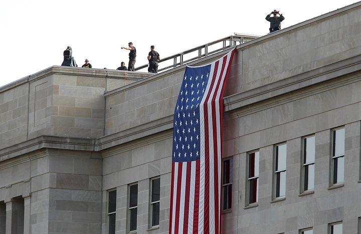 A Secret Service countersniper team looks out from atop the Pentagon during a 10th-anniversary remembrance ceremony at the Pentagon Memorial in Washington on Sunday, Sept. 11, 2011. (AP Photo/J. Scott Applewhite)