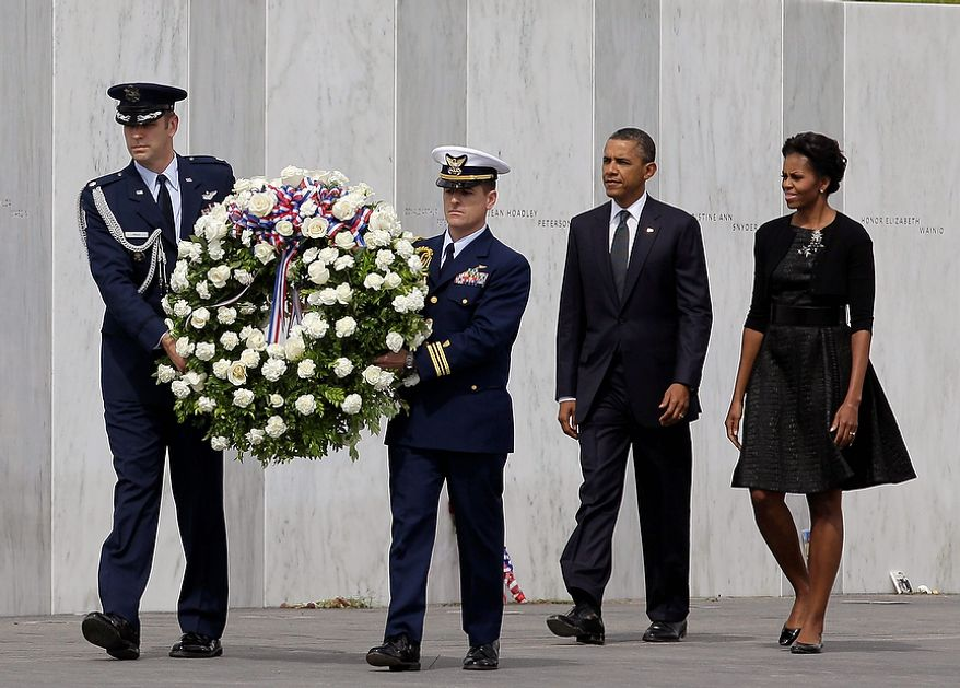 President Barack Obama and first lady Michelle Obama lay a wreath at the Wall of Names at phase 1 of the permanent Flight 93 National Memorial near the crash site of Flight 93 in Shanksville, Pa. Sunday Sept. 11, 2011, on the 10th anniversary of the Sept. 11 attacks. (AP Photo/Amy Sancetta)
