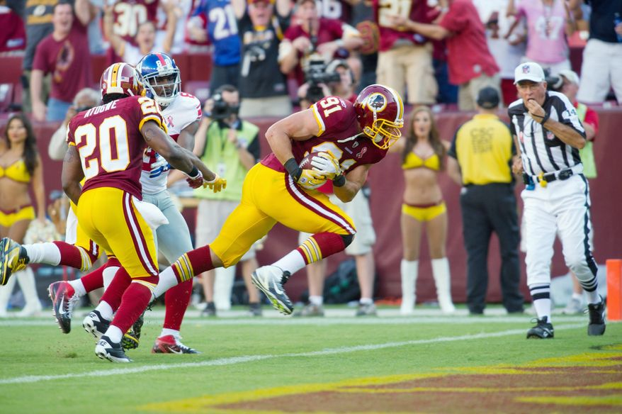 Washington Redskins rookie linebacker Ryan Kerrigan returns an interception for a touchdown to put the Redskins up 21-14 early in the thid quarter. Kerrigan started the play by tipping a pass by Giants QB Eli Manning. (Rod Lamkey Jr./The Washington Times)