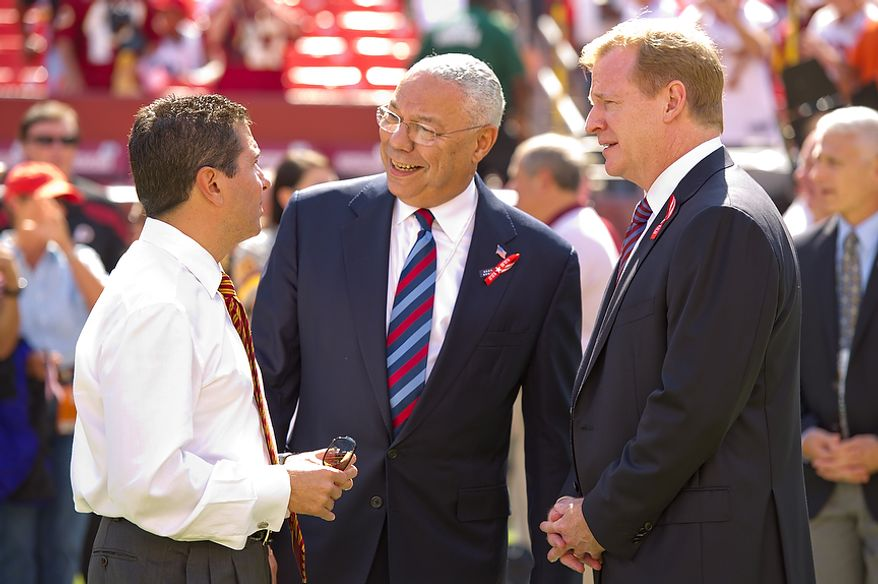 Redskins owner Daniel Snyder, former Secretary of State Colin Powell and NFL commissioner Roger Goodell (left to right) stand on the field before the Washington Redskins play the New York Giants at FedEx Field in Landover, Md. Sunday, September 11, 2011. (Andrew Harnik / The Washington Times)