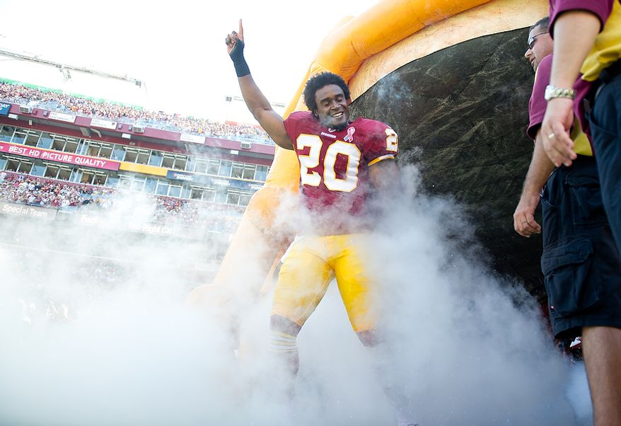 Washington Redskins S Oshiomogho Atogwe (20) takes to the field before playing the New York Giants during the 1st quarter at FedEx Field in Landover, Md. Sunday, September 11, 2011. (Rod Lamkey Jr. / The Washington Times)