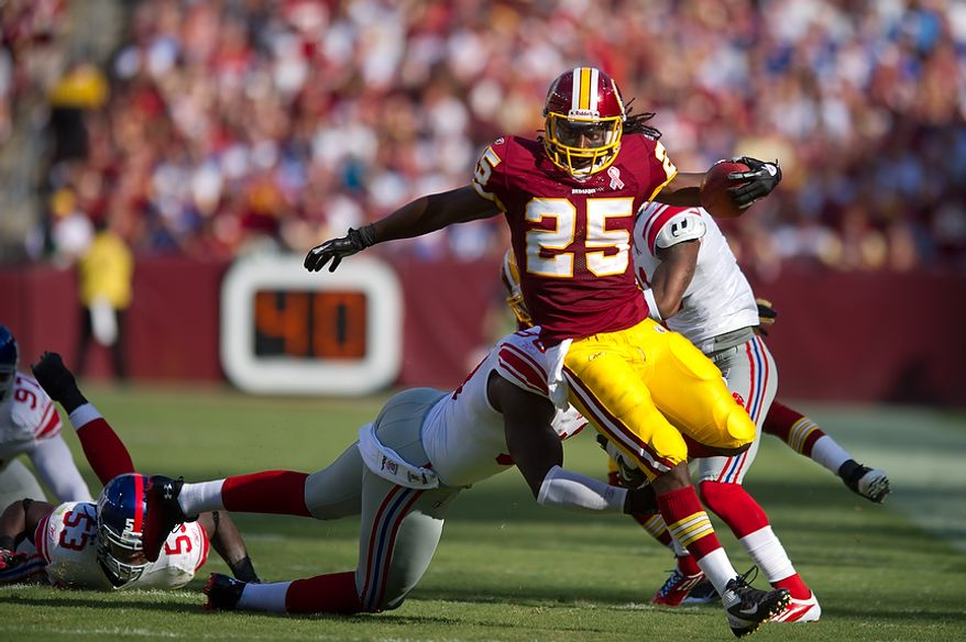 Washington Redskins RB Tim Hightower (25) picks up a first down against the New York Giants during the 1st quarter at FedEx Field in Landover, Md. Sunday, September 11, 2011. (Andrew Harnik / The Washington Times)
