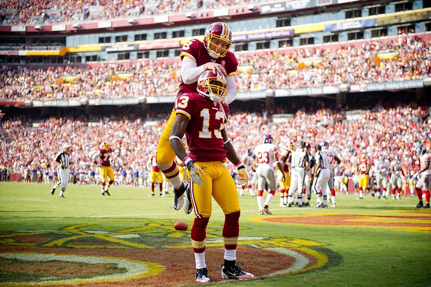 Washington Redskins WR Anthony Armstrong (13) and QB Rex Grossman celebrates a touchdown against the New York Giants tying the game at 14 points during the 2nd quarter at FedEx Field in Landover, Md. Sunday, September 11, 2011. (Andrew Harnik / The Washington Times)