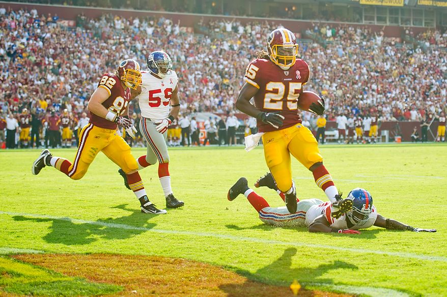 Washington Redskins RB Tim Hightower (25) runs in a touchdown against the New York Giants to tie the game at 7-7 during the 2nd quarter at FedEx Field in Landover, Md. Sunday, September 11, 2011. (Rod Lamkey Jr. / The Washington Times)