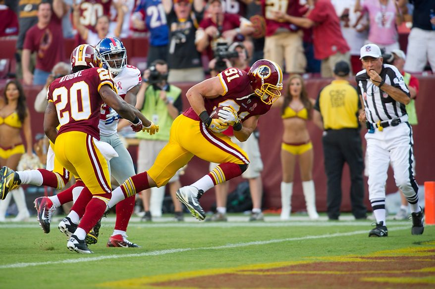 Washington Redskins LB Ryan Kerrigan (91) runs in an interception for a touchdown to take his team up 21-14 against the New York Giants during the 3rd quarter at FedEx Field in Landover, Md. Sunday, September 11, 2011. (Rod Lamkey Jr. / The Washington Times)