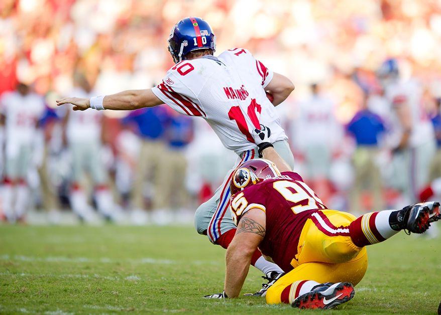 Washington Redskins NT Chris Neild (95) sacks New York Giants QB Eli Manning (10) for a loss of 6 yards during the 3rd quarter at FedEx Field in Landover, Md. Sunday, September 11, 2011. (Andrew Harnik / The Washington Times)