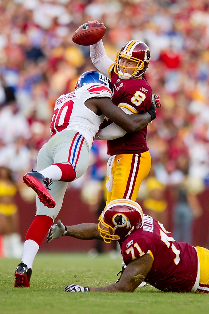 Washington Redskins QB Rex Grossman (8) looses seven yards on a sack by New York Giants DE Jason Pierre-Paul (39) during the 3rd quarter at FedEx Field in Landover, Md. Sunday, September 11, 2011. (Andrew Harnik / The Washington Times)