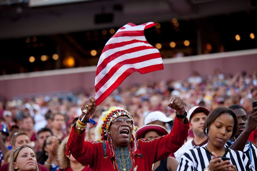 "Redskins fan Zema ""Chief Zee"" Williams reacts as the Washington Redskins play the New York Giants during the 2nd quarter at FedEx Field in Landover, Md. Sunday, September 11, 2011. (Pratik Shah / The Washington Times)"
