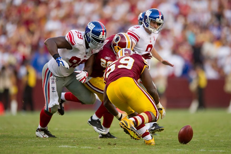 Washington Redskins LB London Fletcher (59) recovers a blocked field goal and runs it for a gain of seven yards agains the New York Giants during the 4th quarter at FedEx Field in Landover, Md. Sunday, September 11, 2011. (Andrew Harnik / The Washington Times)