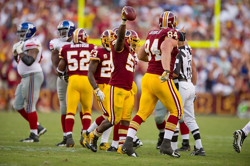 Washington Redskins LB London Fletcher (59) celebrates after recovering a blocked field goal and running it for a gain of seven yards agains the New York Giants during the 4th quarter at FedEx Field in Landover, Md. Sunday, September 11, 2011. (Andrew Harnik / The Washington Times)