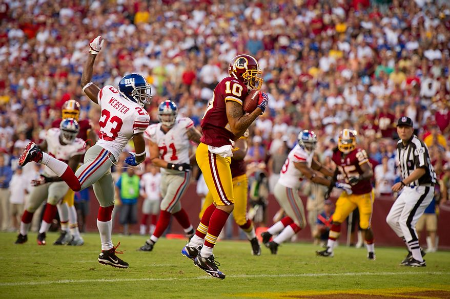 Washington Redskins WR Jabar Gaffney (10) catches a four yard pass for his team's last touchdown making it 27-14 against the New York Giants during the 4th quarter at FedEx Field in Landover, Md. Sunday, September 11, 2011. (Andrew Harnik / The Washington Times)